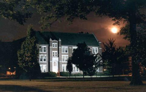 McCray Hall at night with full moon